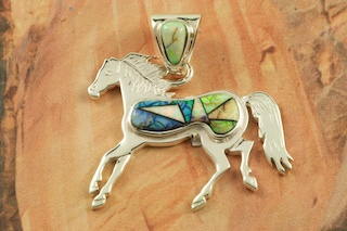 "Horse Pendant featuring Stunning Cultured Opals inlaid in Sterling Silver. This New Beautiful Cultured Opal is Handcrafted in the USA, every Opal is Unique!  Free 18"" Sterling Silver Chain with Purchase of Pendant. Designed by Navajo Artist Calvin Begay. Signed by the artist."