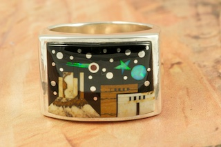 This Ring is a work of art! Beautiful Starry Night in the Pueblo Design with a view of Monument Valley. Featuring Picture Jasper and Black Jade inlaid in Sterling Silver Ring. Beautiful Fire and Ice Lab Opal Moon and Shooting Star! Designed by Navajo Artist Calvin Begay. Signed by the artist.