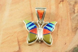 """Beautiful Butterfly Pendant featuring Genuine Sleeping Beauty Turquoise, Spiny Oyster Shell, Gaspeite and Blue Lapis inlaid in Sterling Silver. Free 18"""" Sterling Silver Chain with purchase of pendant.  Designed by Navajo Artist Calvin Begay. Signed by the artist."""