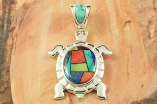 "Beautiful Mosaic featuring Genuine Turquoise, Blue Lapis and Spiny Oyster Shell inlaid in Sterling Silver. Free 18"" Sterling Silver Chain with Purchase of Pendant. Turtle Pendant Designed by Navajo Artist Calvin Begay. Signed by the artist."
