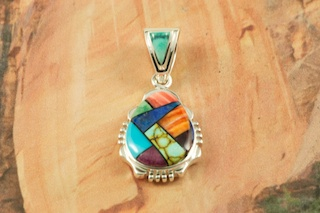"Beautiful Mosaic featuring Genuine Turquoise, Blue Lapis and Spiny Oyster Shell inlaid in Sterling Silver. Free 18"" Sterling Silver Chain with Purchase of Pendant. Designed by Navajo Artist Calvin Begay. Signed by the artist."