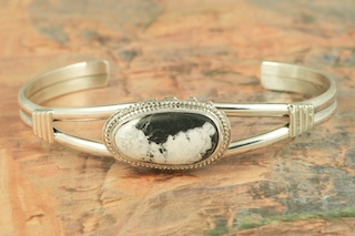 White Buffalo Turquoise set in Sterling Silver Bracelet. This Beautiful Stone is formed from the minerals Calcite and Iron. It is mined near Tonopah Nevada. Created by Navajo Artist Larson Lee. Signed by the artist.