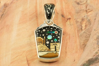"""This Pendant is a work of art! Beautiful Starry Night in the Pueblo Design with a view of Monument Valley. Featuring Picture Jasper and Black Jade inlaid in Sterling Silver Pendant. Beautiful Fire and Ice Lab Opal Moon and Shooting Star! Reversible Pendant with Contemporary Sterling Silver Design. Free 18"""" Sterling Silver Chain with Purchase of Pendant. Designed by Navajo Artist Calvin Begay. Signed by the artist."""