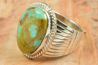 Genuine Manassa Turquoise set in Sterling Silver Ring. This Turquoise is also referred to as King�s Manassa Turquoise. The Manassa Turquoise mine is located in Manassa, Conejos County, Colorado. Created by Navajo Artist Thomas Chischilly. Signed.