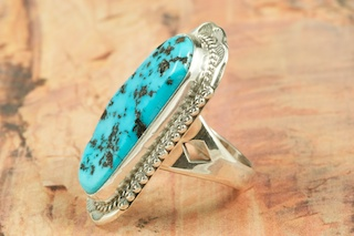 Genuine Sleeping Beauty Turquoise set in Sterling Silver. Created by Navajo Artist John Nelson. Signed by the artist. The Sleeping Beauty Turquoise mine is located in Gila County, Arizona.