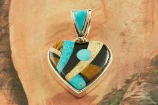 This Heart Pendant is a Work of Art! Featuring Genuine Picture Jasper, Turquoise and Black Jade inlaid in Sterling Silver. Free 18&quot; Sterling Silver Chain with Purchase of Pendant. Designed by Navajo Artist Calvin Begay. Signed by the artist.