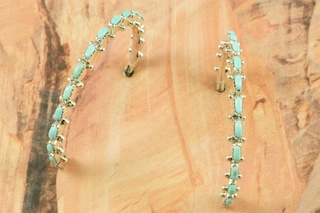 Stunning Hoop Earrings featuring Genuine Sleeping Beauty Turquoise set in Sterling Silver. Beautiful Post Earrings with Petit Point Design. The Sleeping Beauty Turquoise mine is located in Gila County, Arizona. Created by Zuni Artist Harvey Kallestewa. The Zuni Pueblo is located in New Mexico, Land of Enchantment.