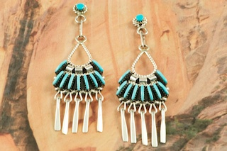 Stunning Earrings featuring Genuine Sleeping Beauty Turquoise set in Sterling Silver. Beautiful Post Earrings with Needle Point Design. The Sleeping Beauty Turquoise mine is located in Gila County, Arizona. Created by Zuni Artist Edmund Cooeyate. Signed by the artist. The Zuni Pueblo is located in New Mexico, Land of Enchantment.