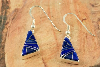 Genuine Blue Lapis inlaid between ribbons of  Sterling Silver. Beautiful Sterling Silver French Wire Earrings Designed by Navajo Artist Calvin Begay. Signed by the artist.