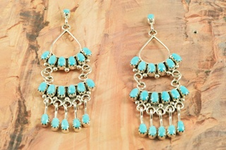 Stunning Earrings featuring Genuine Sleeping Beauty Turquoise set in Sterling Silver. Beautiful Post Earrings with Petit Point Design. The Sleeping Beauty Turquoise mine is located in Gila County, Arizona. Created by Zuni Artist Claudine Penketewa. Signed by the artist. The Zuni Pueblo is located in New Mexico, Land of Enchantment.