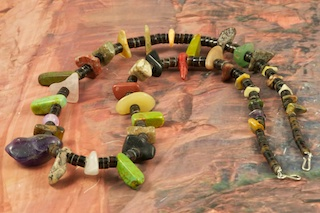 Stunning Native American Necklace with Genuine Assorted Gemstones. Featuring Genuine Turquoise, Amethyst, Red Jasper, Wild Horse, Rose Quartz and Pen Shel Heishi.  The photo is of the Necklace you will be receiving. Created by Santo Domingo Artist Carol Pacheco. The Santo Domingo Pueblo is in New Mexico, near Santa Fe. 