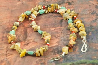 Beautiful Necklace features Genuine Picture Jasper, Turquoise and Red Jasper. Accented with Sterling Silver Beads. Sterling Silver Clasp.  Created by Santo Domingo Artist Carol Pacheco. The Santo Domingo Pueblo is in New Mexico, near Santa Fe. 