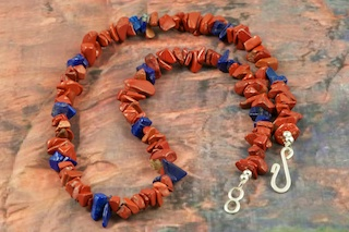 Stunning Necklace featuring Genuine Red Jasper with Blue Lapis Accents.  Sterling Silver Beads and Clasp.  Created by Santo Domingo Artist Carol Pacheco. The Santo Domingo Pueblo is in New Mexico, near Santa Fe. 