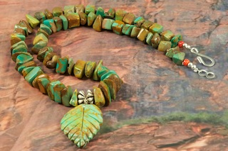 Beautiful Necklace featuring Genuine Kingman Turquoise with Hand Carved Leaf. Accented with Sterling Silver Fluted Beads and Clasp.  Created by Santo Domingo Artist Carol Pacheco. The Santo Domingo Pueblo is in New Mexico, near Santa Fe.