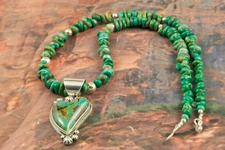 Stunning Pendant and Necklace Set featuring Genuine Manassa Turquoise set in Sterling Silver. This Turquoise is also referred to as Kings Manassa Turquoise. The Manassa Turquoise mine is located in Manassa, Conejos County, Colorado. Created by Navajo Artist Lucy Valencia. Signed L. J. by the artist.