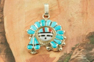 "Beautiful Zuni Sun Face Headdress, the Sunface represents Prosperity & Happiness. Featuring Genuine Sleeping Beauty Turquoise, Red Coral, Mother of Pearl and Jet inlaid between ribbons of Sterling Silver. Created by Zuni Artist Larry Lonjose. Signed by the artist. Free 18"" Sterling Silver Chain with Purchase of Pendant. The Zuni Pueblo is located in New Mexico, Land of Enchantment."