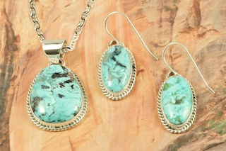 Beautiful Pendant and Earrings Set featuring Genuine Blue Diamond Turquoise set in Sterling Silver. Created by Navajo Artist Tony Garcia. Signed by the artist. Free 18 inch Sterling Silver Chain. The Blue Diamond mine, located in central Nevada, opened in the late 1950�s and was mined up to 1980. This mine is considered a �hat mine� of which there are very few. A hat mine is a small deposit of turquoise that, �you can cover with your hat.� This mine is now closed and buried under thousands of tons of rock.