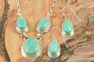Genuine Number 8 Mine Turquoise Stones set in Sterling Silver. Beautiful Necklace and Earrings Set. Created by Navajo Artist Lucy Valencia. Signed by the artist. The photo is of the jewelry you will be receiving. The Number 8 mine is located in Eureka County Nevada. Since 1976 there has been no Number 8 Turquoise mined. There is however, an existing stock pile that Mr. Dowell Ward, the last owner of the Number 8 mine, had stocked away for later sorting. The Turquoise is a collector's item--because once the reserve is gone there will be no more material released onto the market. The Gold Mining Company owns the claim to the Number 8 mine and it has been swallowed up by the gold mining operations. This is some of the last Number 8 Turquoise to be had and will be a great addition to your collection.