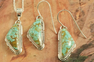Genuine Number 8 Mine Turquoise Stones set in Sterling Silver. Beautiful Pendant and Earrings Set with an 18&quot; Sterling Silver Chain. Created by Navajo Artist Larson Lee. Signed by the artist. The Number 8 mine is located in Eureka County Nevada. Since 1976 there has been no Number 8 Turquoise mined. There is however, an existing stock pile that Mr. Dowell Ward, the last owner of the Number 8 mine, had stocked away for later sorting. The Turquoise is a collector's item--because once the reserve is gone there will be no more material released onto the market. The Gold Mining Company owns the claim to the Number 8 mine and it has been swallowed up by the gold mining operations. This is some of the last Number 8 Turquoise to be had and will be a great addition to your collection. 
