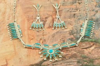 Stunning Necklace and Post Earrings featuring Genuine Sleeping Beauty Turquoise set in Sterling Silver. Beautiful Needle Point Design. Created by Zuni Artist Rena Cachini. Signed by the artist. The Zuni Pueblo is located in New Mexico, Land of Enchantment.