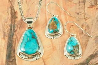 Stunning Pendant and Earrings Set featuring Genuine High Grade Apache Blue Turquoise set in Sterling Silver. Created by Navajo Artist Phillip Sanchez. Signed by the artist. Free 18 inch Sterling Silver Chain. The Apache Blue Mine turquoise mine, is a small mine with lots of potential. The mine is located near Tonopah, Nevada in the Candelaria Mountain range. 