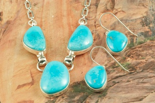 Genuine Castle Dome Turquoise set in Sterling Silver. Stunning Necklace and Earrings Set. The Castle Dome Turquoise Mine is located about 30 miles from the Sleeping Beauty Mine, near Globe, Arizona. The Castle Dome Mine has not been in operation since the early 1970s. The photo is of the jewelry you will be receiving. Created by Navajo Artist Tony Garcia. Signed by the artist.