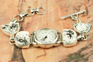 4 Beautiful White Buffalo Turquoise Stones set in Sterling Silver Watch Bracelet. This Beautiful Stone is formed from the minerals Calcite and Iron. It is mined near Tonopah Nevada. This Beautiful Bracelet is a one of a kind Bracelet. The photo is of the jewelry you will be receiving. Created by Navajo Artist Tony Garcia. Signed by the artist.