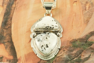 "White Buffalo Turquoise set in Sterling Silver Pendant. This Beautiful Stone is formed from the minerals Calcite and Iron. It is mined near Tonopah Nevada. Free 18"" Sterling Silver Chain with Purchase of Pendant. Created by Navajo Artist Lucy Valencia. Signed L. J. by the artist."