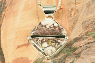 "Genuine Wild Horse set in Sterling Silver Pendant. Free 18"" Sterling Silver Chain with Purchase of Pendant. This stone also known as Crazy Horse is mined near Globe, Arizona. Created by Navajo Artist Eva King. Signed by the artist."