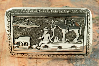 Beautiful Cowboy and Horse Design in this Sterling Silver Belt Buckle. Created by Navajo Artist Tommy Singer. Signed by the artist. Tommy Singer passed away on May 31st, 2014. This is the last of his jewelry that we will be receiving.