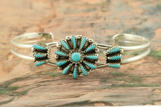Genuine Sleeping Beauty Turquoise set in Sterling Silver Bracelet. Beautiful Petit Point Design. The Sleeping Beauty Turquoise mine is located in Gila County, Arizona. Created by Zuni Artist Judy Wallace. The Zuni Pueblo is located in New Mexico, Land of Enchantment.