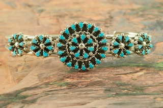 Genuine Sleeping Beauty Turquoise set in Sterling Silver Bracelet. Beautiful Petit Point Design. The Sleeping Beauty Turquoise mine is located in Gila County, Arizona. Created by Zuni Artist Trudy Quetawki. The Zuni Pueblo is located in New Mexico, Land of Enchantment.