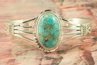 Genuine Battle Mountain Turquoise set in Sterling Silver Bracelet. The Battle Mountain Turquoise Mine is located on the Shoshone Indian Reservation in Nevada.  Created by Navajo Artist Freddy Charley. Signed by the artist.