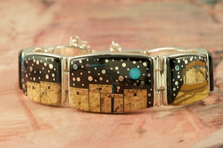 Starry Night at the Pueblo with a view of Monument Valley. Genuine Picture Jasper and Acoma Jet inlaid in Sterling Silver. Beautiful Fire and Ice Lab Opal Heart Line, Mystical Yei, Moon and Shooting Star! Bracelet Designed by Navajo Artist Calvin Begay. Signed by the artist.