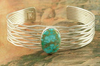 "Genuine Turquoise Mountain Mine Turquoise set in Sterling Silver Bracelet. Created by Navajo Artist Murphy Platero. Signed by the artist. The Turquoise Mountain Mine is located in the Mineral Park Mining District, Mohave County, Arizona. Although Turquoise Mountain is located near the Kingman Turquoise Mine it is considered a classic mine in its own right because the Turquoise is so different in appearance. It is also known as ""Old Man Turquoise""."