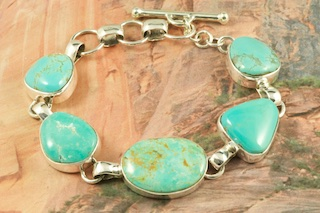 5 Genuine Manassa Turquoise Stones set in Sterling Silver Bracelet. This Turquoise is also referred to as King�s Manassa Turquoise. The Manassa Turquoise mine is located in Manassa, Conejos County, Colorado. Created by Navajo Artist Lyle Piaso. Signed by the artist.