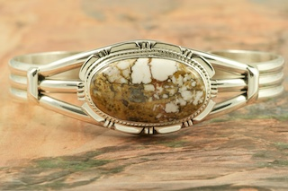 "Genuine Wild Horse Stone set in Sterling Silver Bracelet. This stone is also known as ""Crazy Horse"". It is mined near Globe, Arizona. Created by Navajo Artist Kathy Yazzie. Signed by the artist."