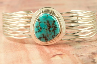 Beautiful Sterling Silver Bracelet featuring Genuine Sleeping Beauty Turquoise. The Sleeping Beauty Turquoise mine is located in Gila County, Arizona. The mine is now closed and the stones are obtained from private collections. Created by Navajo Artist Murphy Platero. Signed by the artist.