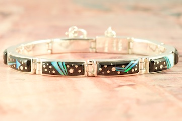 Stunning Starry Night Design featuring Genuine Acoma Jet inlaid in Sterling Silver. Beautiful Fire and Ice Lab Opal Heart Line Design and Shooting Star! Bracelet Designed by Navajo Artist Calvin Begay. Signed by the artist.