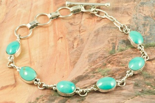 Genuine Sleeping Beauty Turquoise set in Sterling Silver Bracelet. The Sleeping Beauty Turquoise mine is located in Gila County, Arizona. The Sleeping Beauty Turquoise mine is now closed. The stones are obtained from private collections. Created by Navajo Artist Geneva Chavez. Signed by the artist.