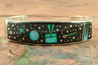 Stunning Starry Night Design featuring Genuine Black Jade inlaid in Sterling Silver. Beautiful Fire and Ice Lab Opal Moon and Shooting Star! Beautiful Bracelet Designed by Navajo Artist Calvin Begay. Signed by the artist.