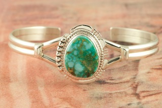 Genuine Manassa Turquoise Stone set in Sterling Silver Bracelet. This Turquoise is also referred to as King's Manassa Turquoise. The Manassa Turquoise mine is located in Manassa, Conejos County, Colorado. Created by Navajo Artist John Nelson. Signed by the artist.