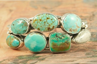Sterling Silver Bracelet featuring Genuine Candelaria Turquoise, Turquoise Mountain Turquoise, King's Manassa Turquoise, Castle Dome Turquoise, Number 8 Mine Turquoise, Royston and White Buffalo Turquoise. Created by Navajo Artist Evelyn Yazzie. Signed by the artist.