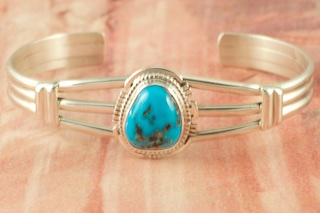 Sterling Silver Bracelet featuring Genuine Sleeping Beauty Turquoise. The Sleeping Beauty Turquoise mine is located in Gila County, Arizona. The mine is now closed and the stones are obtained from private collections. Created by Navajo Artist Larson Lee. Signed by the artist.