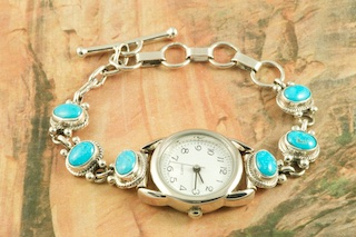 Watch Bracelet featuring 6 Beautiful Genuine Sleeping Beauty Turquoise Stones set in Sterling Silver. The Sleeping Beauty Turquoise mine is located in Gila County, Arizona. The mine is now closed and the stones are obtained from private collections. Created by Navajo Artist Genva Chavez. Signed by the artist.
