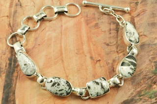 Genuine White Buffalo Turquoise set in Sterling Silver Bracelet. This Beautiful Stone is formed from the minerals Calcite and Iron. It is mined near Tonopah Nevada. Created by Navajo Artist Tony Garcia. Signed by the artist.