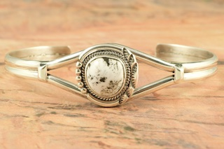 Genuine White Buffalo Turquoise set in Sterling Silver Bracelet. This Beautiful Stone is formed from the minerals Calcite and Iron. It is mined near Tonopah Nevada. Created by Navajo Artist Evelyn Yazzie. Signed by the artist.