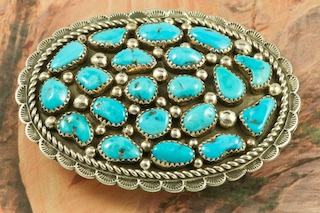 Sterling Silver Belt Buckle featuring Genuine Sleeping Beauty Turquoise. The Sleeping Beauty Turquoise mine is located in Gila County, Arizona. The mine is now closed and the stones are obtained from private collections. Created by Navajo Artist Darlene Begay. Signed by the artist.