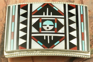 Beautiful Sun Face Design featuring Genuine Sleeping Beauty Turquoise, Mother of Pearl, Jet and Red Coral inlaid in Sterling Silver Belt Buckle. Created by Zuni Artist Ricky Vacit. Signed by the artist.