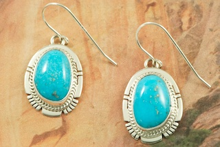 Genuine High Grade Kingman Web Turquoise set in Sterling Silver Earrings. Created by Navajo Artist Larson Lee. Signed by the artist. The Mineral Park Mine, in the Cerbat Mountains 14 miles northwest of Kingman, was first mined by Indians centuries before white man came to the area. It is one of the three sites of prehistoric mining localities in the state of Arizona. Mineral Park was the most extensively worked area by the Indians of the three. S.A. �Chuck� Colbaugh found a cache of stone hammers uncovered in ancient trenches and tunnels, when he had the turquoise mining concession in May of 1962. Ithaca Peak and Turquoise Mine (formally called Aztec Mountain or Aztec Peak) are the most famous of the peaks in the area containing turquoise.